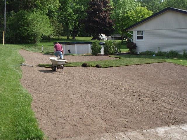 Bob's Grading sodding a freshly graded lawn.